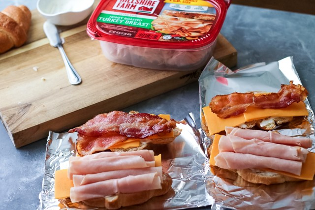 Turkey Bacon Ranch Melts are your new favorite sandwich!! Melty cheese, crispy bacon, turkey and ranch all warm and tucked into a buttery croissant.