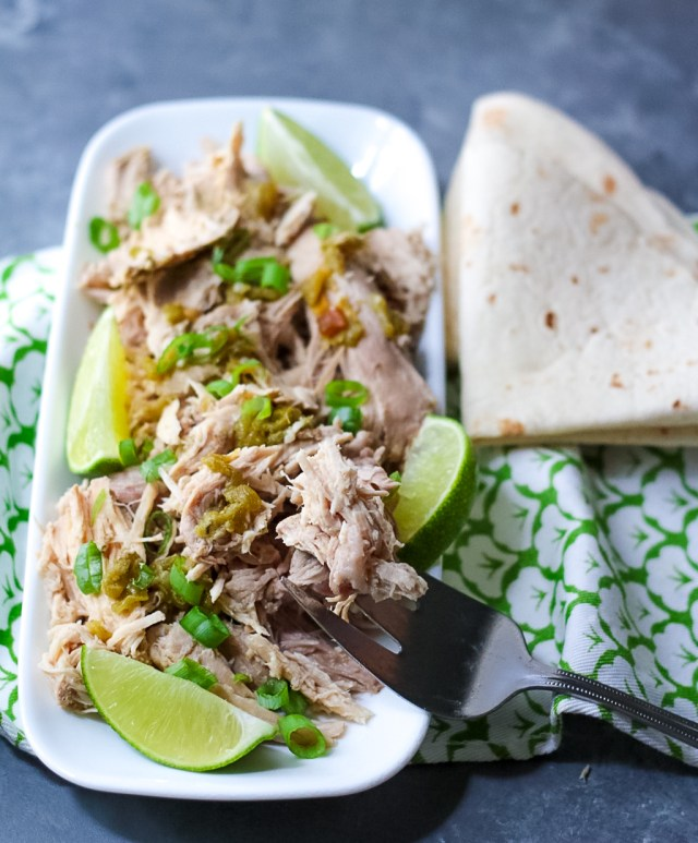 Slow Cooker Green Chile Pork is the 5 ingredient dinner that is ready when you are! You can use it in so many ways, like tacos!