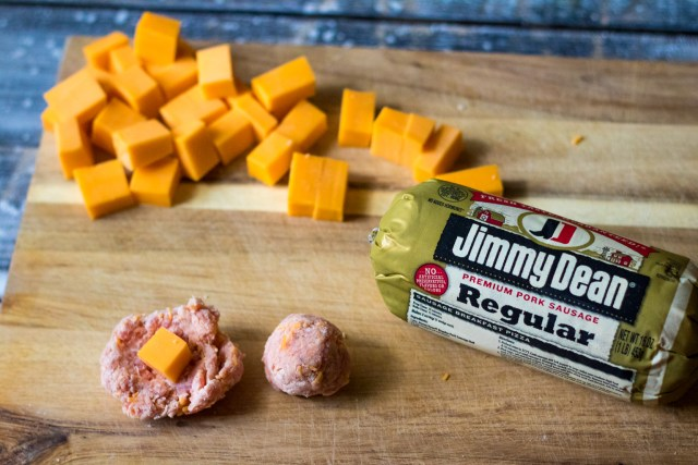 Sausage Ball Biscuit Bombs are stuffed with cheese and then baked in a biscuit bomb and topped with everything bagel seasoning to create the perfect bite!