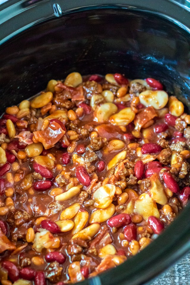 Slow Cooker Beefy Calico Beans are thick, rich and full of bacon and ground beef. Perfect for cookouts and a real crowd pleaser!