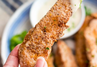 Garlic Parmesan Crispy Chicken Tenders have a secret ingredient to make them the crispiest chicken tenders, with a creamy garlic parm sauce for dipping!