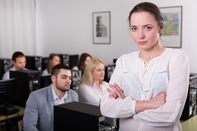 Corporate Uniform young teacher in class