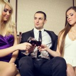 Discover Great Luxurious Brothel Services Around The World one man and two sexy women having a drink at a bar