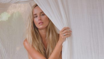 Important Things to Consider While Selecting Curtains blonde woman looking through curtain
