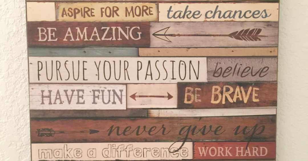 wall hanging of various wood pieces with motivational writing