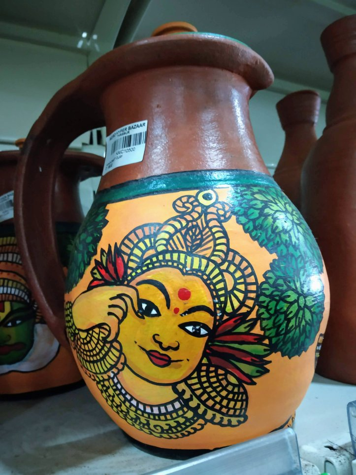 Mural painting on terracotta pot Buy from God's own country.