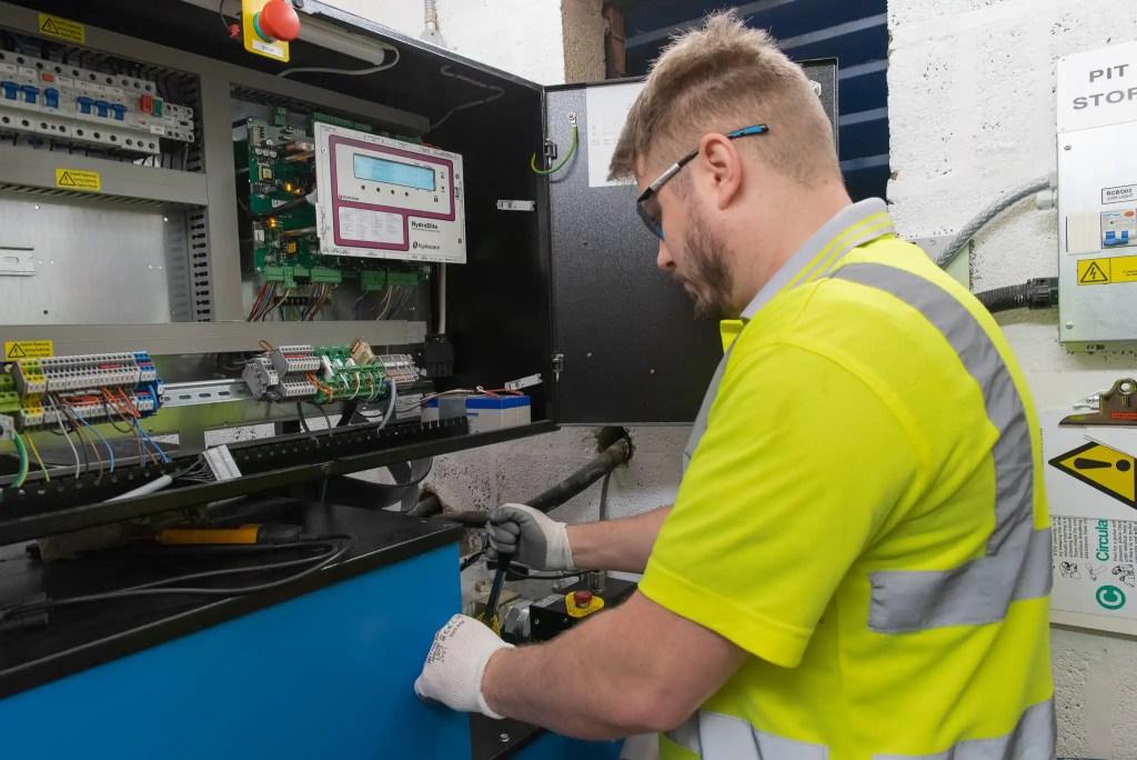 Engineer working on control panel