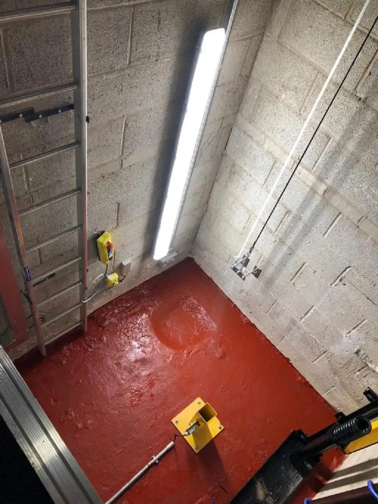 Cleaned and painted lift pit