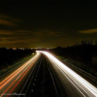 Night-time traffic on the M18 motorway, with Shannon Town visible in the distance. Photo by Martin Molloy https://www.facebook.com/pages/Martin-Molloy-Photography/1488270208089779