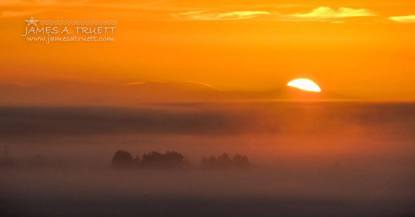 The final sunrise of November 2014, as captured by James A. Truett from the hills overlooking Lissycasey