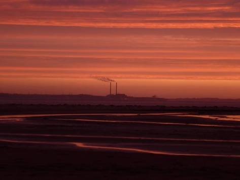 Moneypoint at sunrise as seen from across the Estuary at Beal Strand, Co Kerry. Photo Ita Hannon
