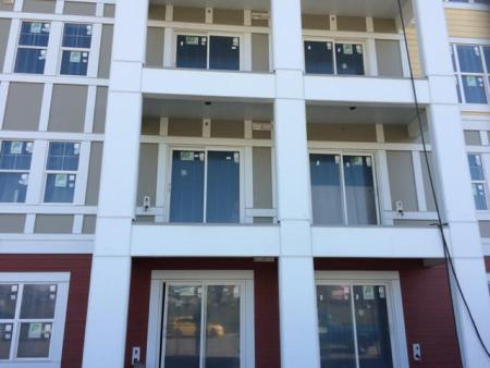 Windows and doors on large multi family building