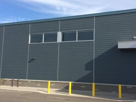 Commercial grade exterior cement panels on business