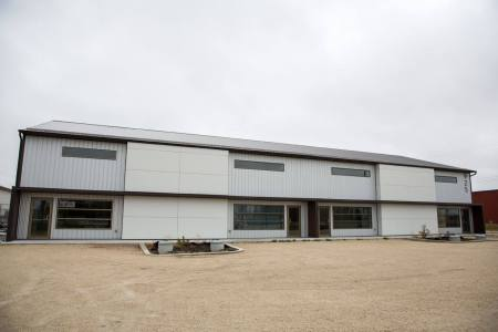 Commercial multi door building with aluminum siding
