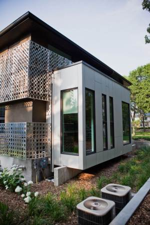Custom built Winnipeg home with custom installed siding with Hardie panels and cut metal privacy screens