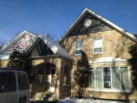 Heritage home with new soffit, fascia and eavestrough with trim