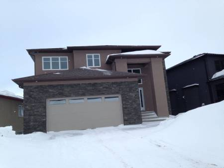 New home construction with exterior stone feature