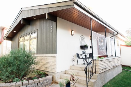 Winnipeg bungalow with vertical siding and longboard