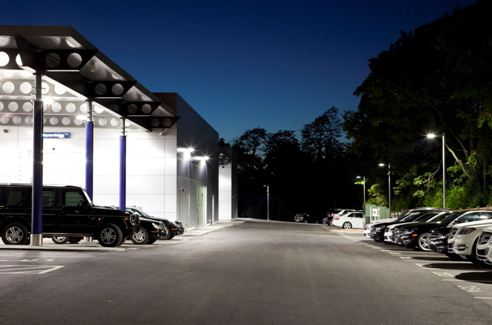 Outdoor lighting control is trending toward individual multilevel control. At the Collection Auto Group Fort Mitchell dealership, the lights dim to 10 percent of light output at night (schedule) but automatically ramp up to full output if a vehicle approaches (occupancy sensing). Image courtesy of GE Lighting.