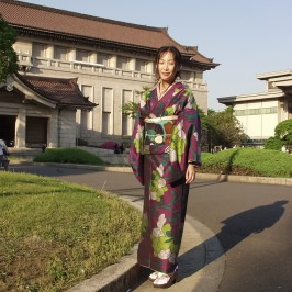 Woman in purple kimono with floral pattern