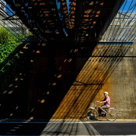 Bicycle and shadow under the bridge