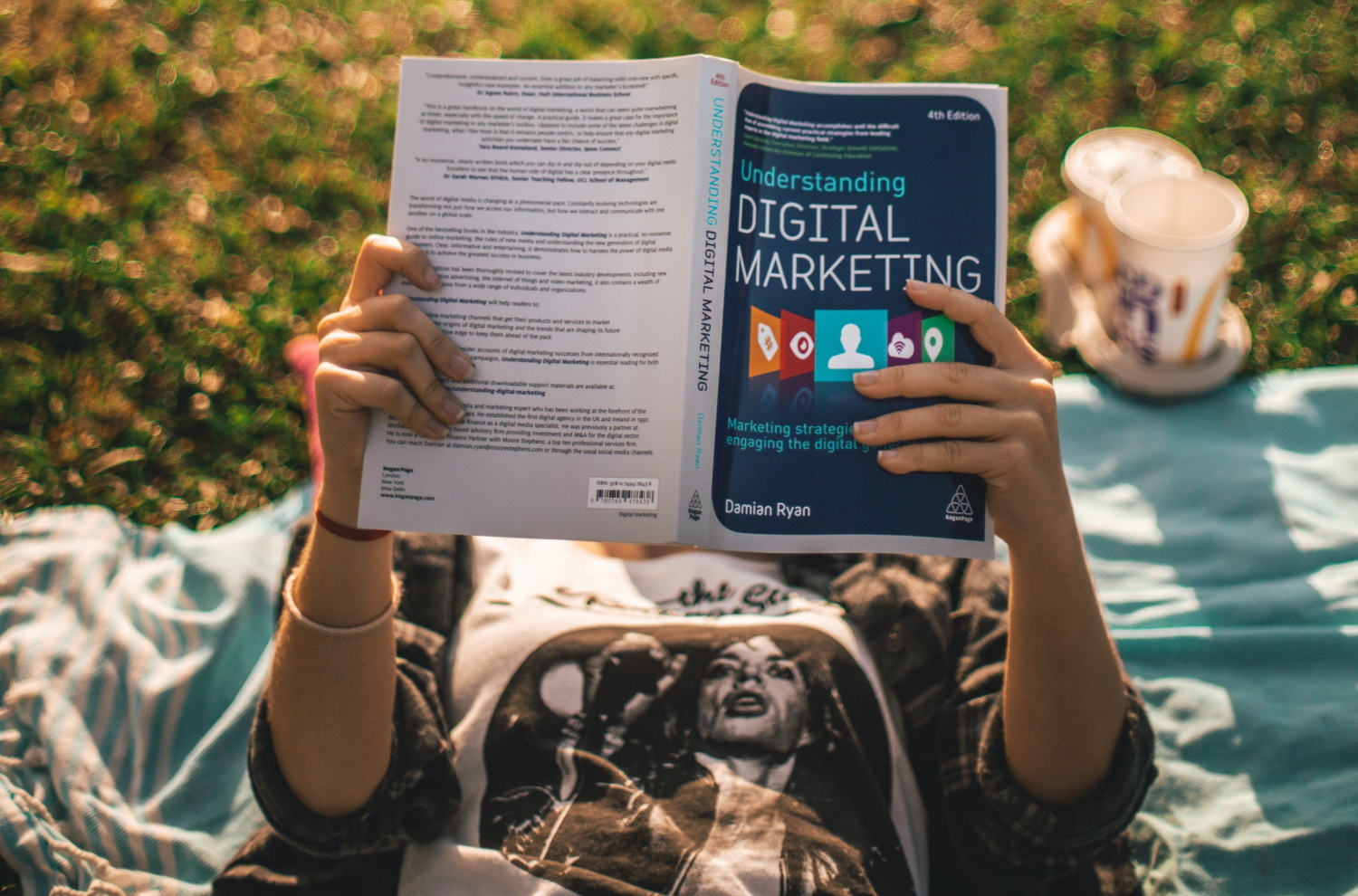person reading book on digital marketing terms