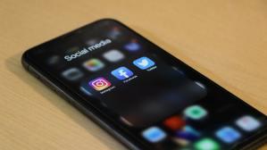 managing social media | phone screen with social media app icons