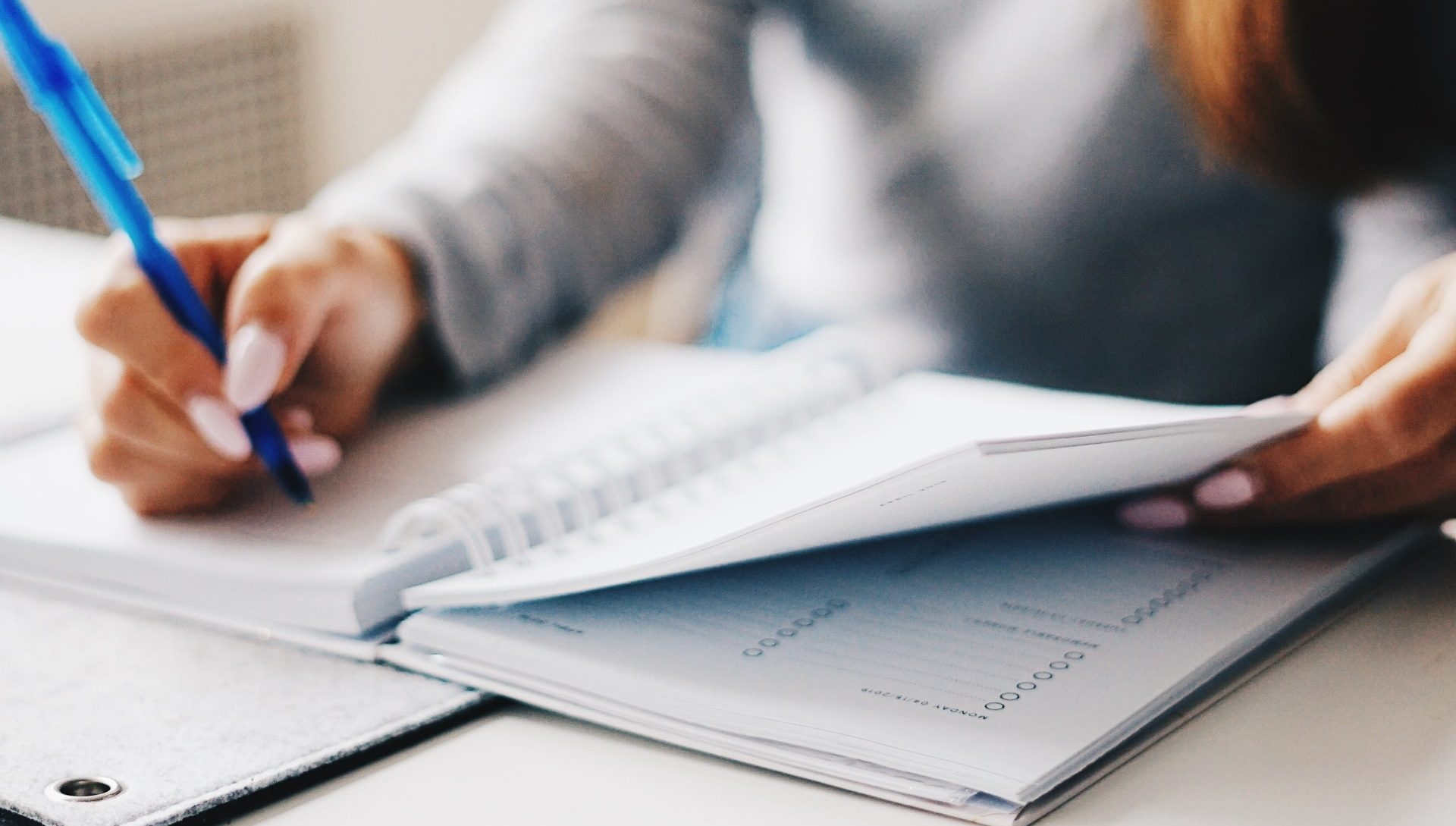 content marketing lessons | close up of woman writing in a planner