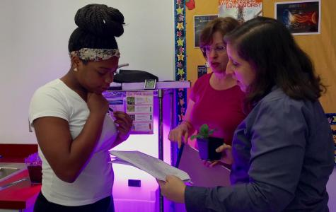 Catherine Raymond visits Ms. Leonard's environmental class to evaluate the NASA project