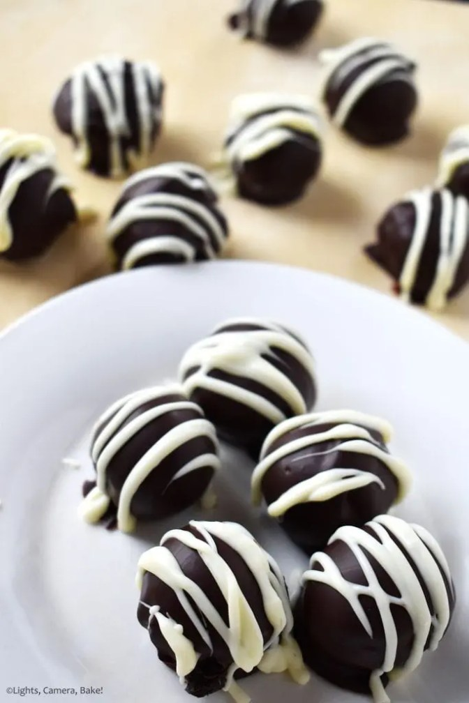 Portrait of Oreo Truffles covered in melted chocolate and drizzled with melted white chocolate for the professional and indulgent finish.