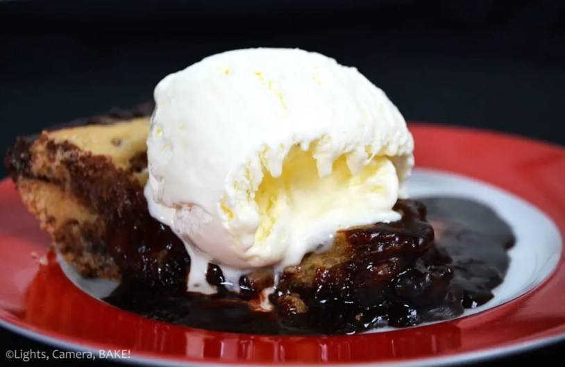 Hot Fudge Cookie Pie. Gooey, chewy, thick, deep-dish chocolate chip cookie filled with a homemade hot fudge chocolate sauce and baked as a pie! So good and so delicious served with ice cream. #hotfudgechocolatesauce #hotfudgecookiepie #cookiepie