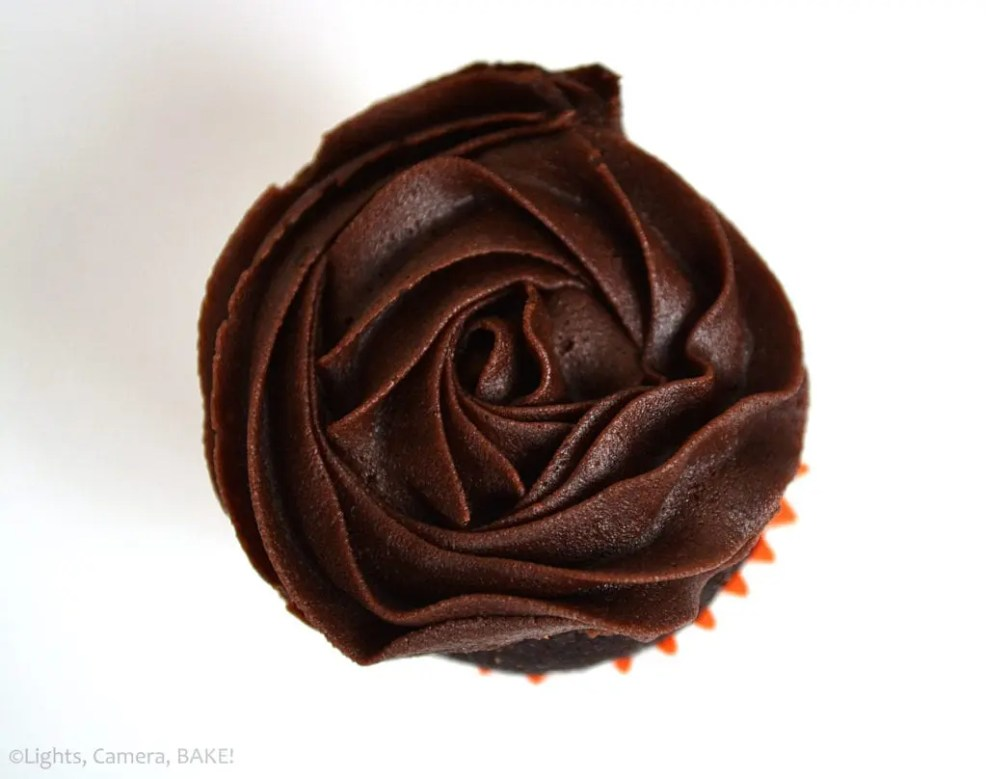 Mini Chocolate Cupcakes are a soft and fluffy chocolate cupcake topped with a rich chocolate buttercream. Mini chocolate cupcakes mean they are perfect finger food for events or - if you're like me - it means you can have a handful and not feel so bad going for a second... or a third!
