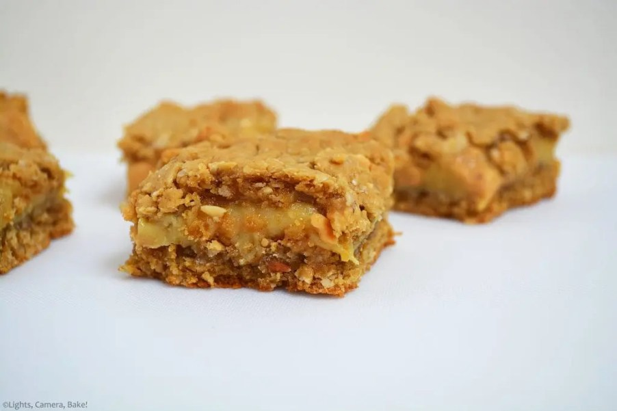 Three pieces Peanut Butter Caramel Oat Slice. Crunchy oat base with a gooey condensed milk caramel center