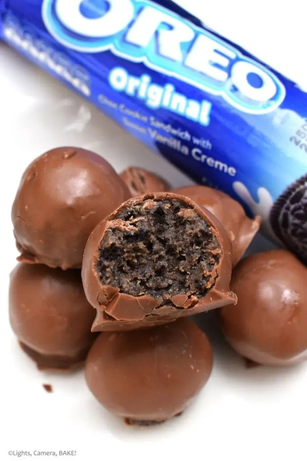 Caramel Oreo Truffles take a rich and buttery caramel and crushed Oreos to create a sweet, rich, caramel/cookies and cream truffle covered in melted chocolate. #oreotruffles #caramel #carameltruffles #carameloreotruffles #oreorecipes