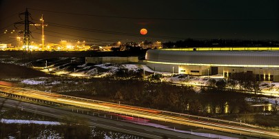 MAX IV Laboratory in Lund (Sweden) at night with supermoon (2014). (Credit: Salar Haghighatafshar)