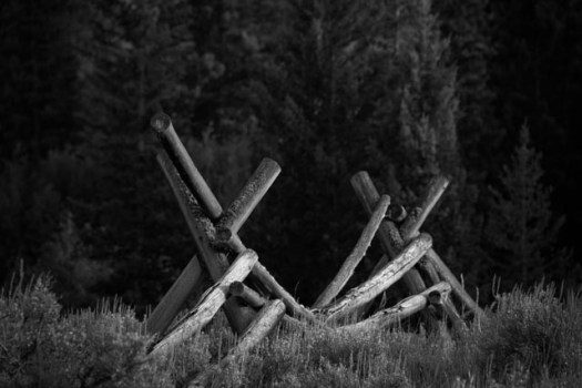 Old fence posts along the edge of the Chief Joseph Scenic Byway, in northwest Wyoming. The Chief Joseph Scenic Byway winds through the mountains connecting the town of Cody, Wyoming with the Beartooth Highway and the Northeast Gate of Yellowstone National Park