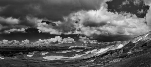Clouds dance across the sky on a summer day along the Beartooth Highway, whcih runs between Montana and Wyoming.