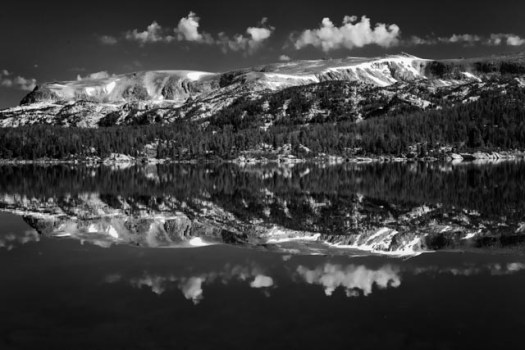 The Beartooth mountains reflect i n Island lake along the Beartooth Highway,. The highway, which rises to almost 11,000 feet, runs between Montana and Wyoming.,