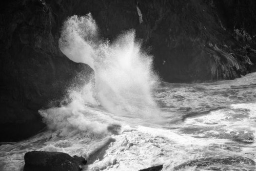 Wave crash against the rocks at the Rocky Creek Bridge Wayside on Otter Crest Loop road on the central Oregon coast.