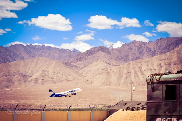 A plane flying near the Hall of Fame in Leh