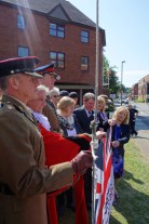 Holding the flag for photographs
