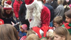 8-Children dive into Santa's bucket of gifts