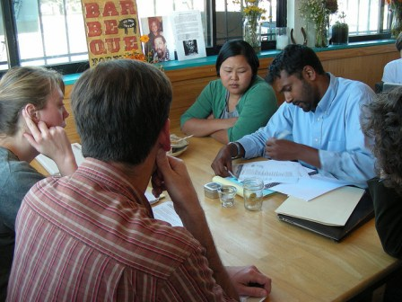 Attorney Sushil Jacob and apprentice Thea Chhun advice clients at the Legal Cafe