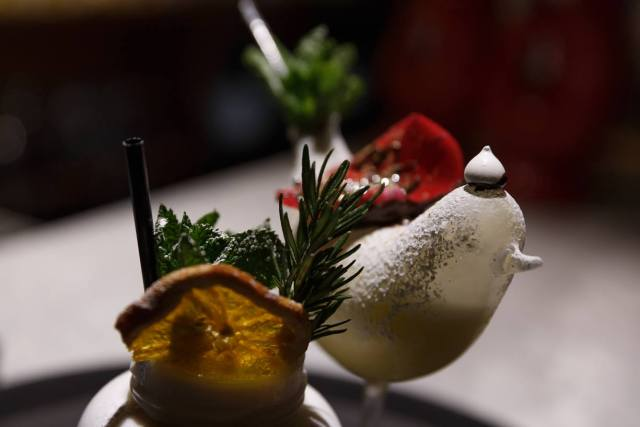 cocktail served in a bird shaped container