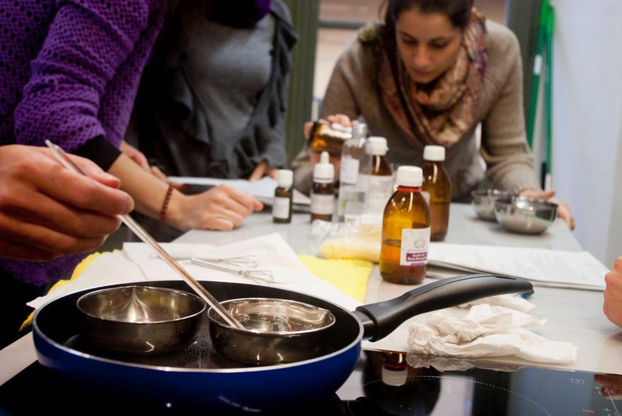 women-using-raw-materials-in-bottles-to-make-natural-cosmetics