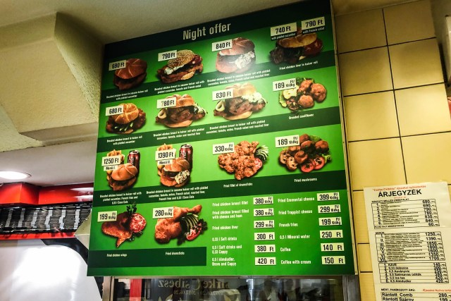 green menu filled chicken dishes with prices
