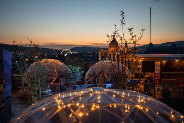 igloos on a rooftop bar in budapest with a panoramic view over the city