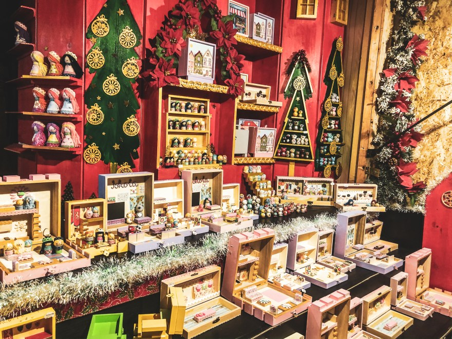 stall with a display of christmas trees and multi-coloured boxes containing hand made crafts