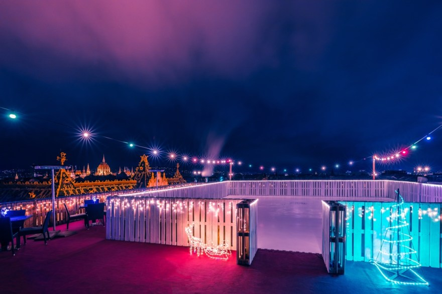 neon-lit-purple-blue-rooftop-outdoor-ice-rink