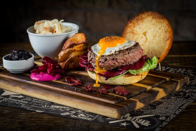 beef burger with fried egg and runny yolk beetroot